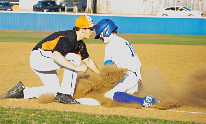 Pictured above, Grant Elerick slides safely into third base.