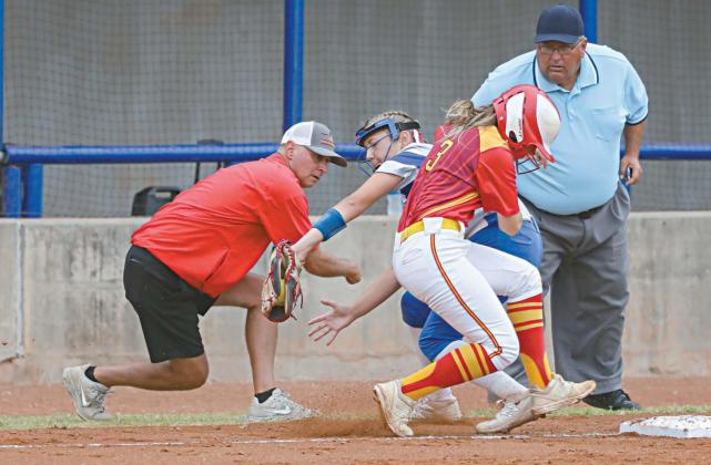 Stroud third baseman Makenna Hall takes a throw as Dale's Emmie Idleman gets back to the base during the state semifinals last week. Looking on are Dale coach Andy Powell and The Blue. Photo/Rick Hester
