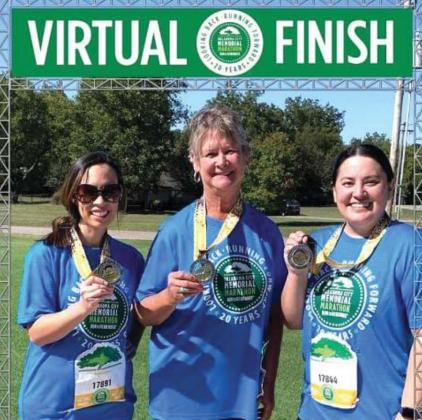 With medals in hand, Elizabeth Lau, Julie Bivin and Tiffany Morris stand at the virtual finish line of the OKC Memorial Run to Remember half marathon. Photo/submitted.
